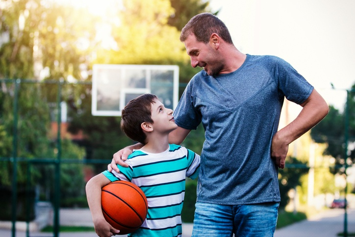 Family Playing Basketball After Loan Approval from Mortgage Broker
