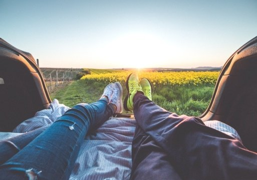 Couple Watching Sunset from Back of Truck